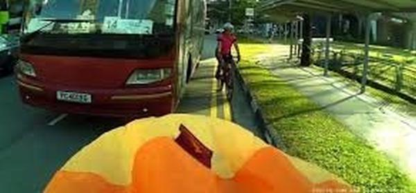 Woman falls off bike as bus drove too close to her