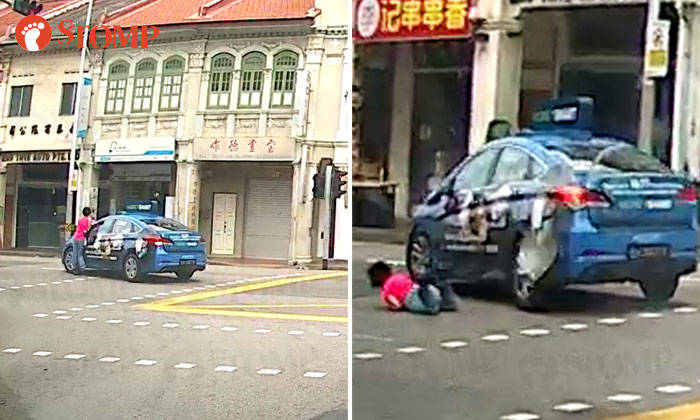 Pedestrian got knocked down by taxi, even though green light in her favour