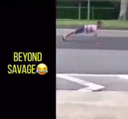 Daredevil Boy Does Push Ups in the Middle of the Road